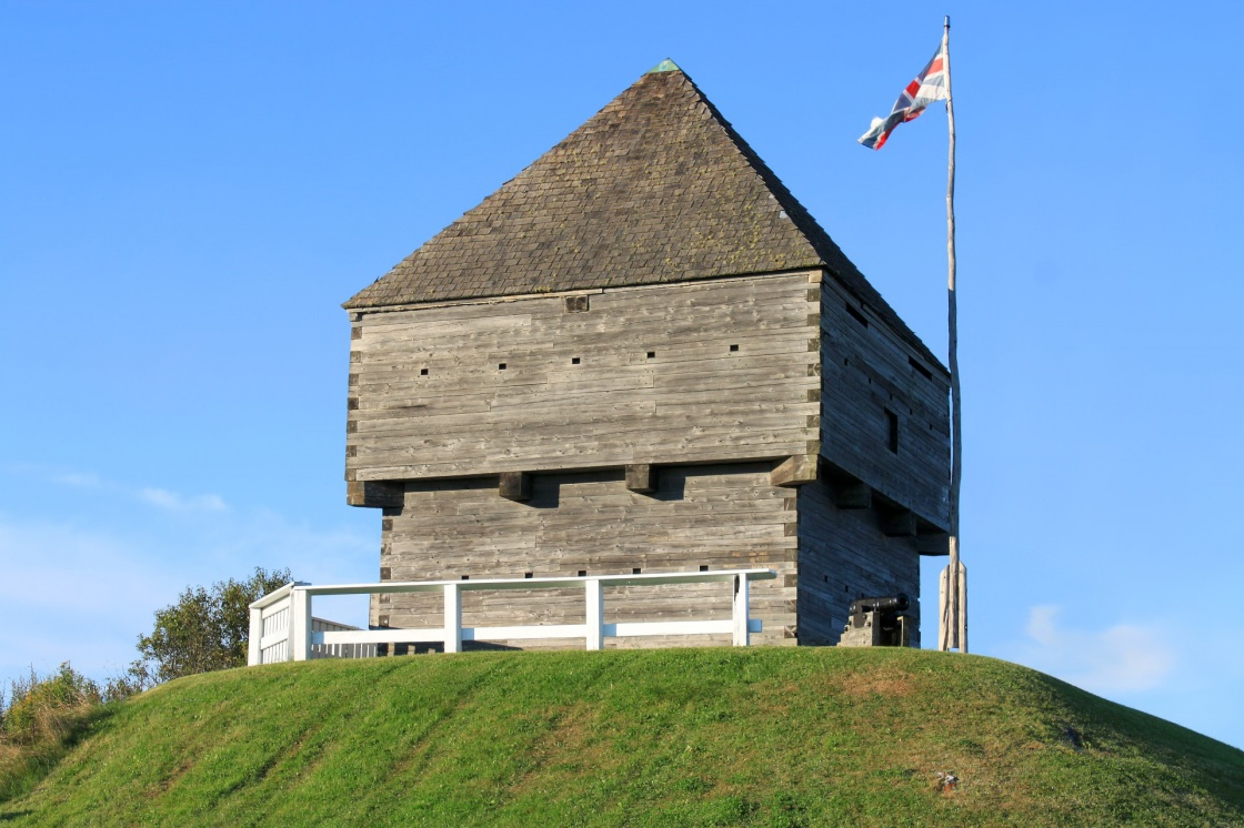 Forth Howe, the site of an 18th and 19th century British Army fortification on a hill in Saint John, New Brunswick, Canada surrounded by blue sky with waving flag